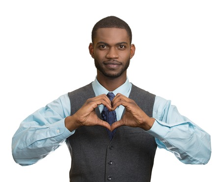 Portrait handsome smiling young business man makes hand heart shape using fingers isolated white background. Positive human emotions, facial expressions, feelings, body language, attitude photo