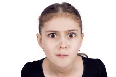 obsessive: Closeup portrait skeptical young girl looking suspicious, disapproval, surprise on face isolated white background. Negative human emotion, facial expression feeling attitude, body language, perception Stock Photo