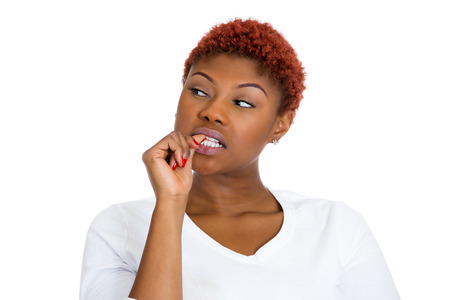 insecure: Closeup portrait woman with finger in mouth Stock Photo