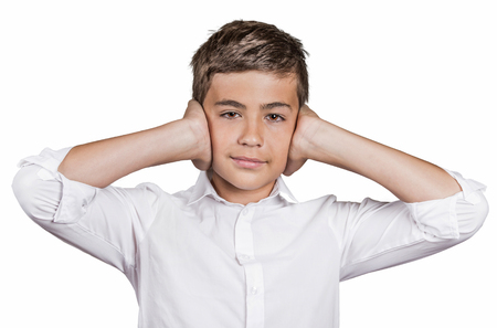 wrongful: Portrait teenager boy covering ears with hands, doesnt want to hear loud noise, ignoring conversation isolated white background. Human face expression, emotion, feelings, reaction life perception Stock Photo