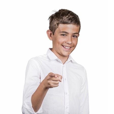 fullness: Portrait happy young man, teenager laughing, pointing with finger at someone, something, isolated white background. Positive human face expressions emotion, feeling, attitude, approach, perception