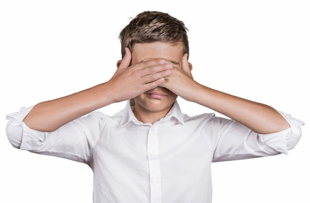 wrongful: Portrait young shy man closing covering eyes with hands cant see, hiding, isolated white background. See no evil concept turning wrongful in good. Human emotion facial expression feeling reaction Stock Photo