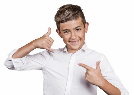 lets: Closeup portrait young man, handsome happy guy, teenager making call me gesture sign with hand shaped like phone, lets be friends, isolated white background. Positive human emotions, face expressions