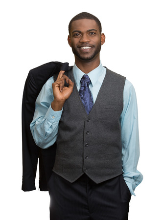 ethnic attire: Confident employee. Portrait smiling, handsome young business man in full suit keeping arm in pockets, looking at camera, isolated white background. Human face expression, emotion, body language