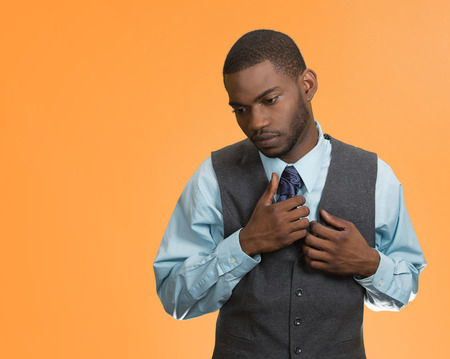 introvert: Awkward situation, shy, sad young handsome business man, isolated orange background. human emotions, feelings, face expressions, body language,life perception, workplace subordination, lack of opinion Stock Photo