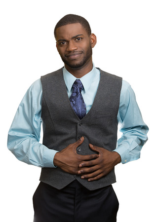 Portrait guy with stomach pain, miserable, upset, ill, unhealthy, young man, doubling over, looking very sick unwell isolated white background. Facial expressions, emotions, reaction health issues photo
