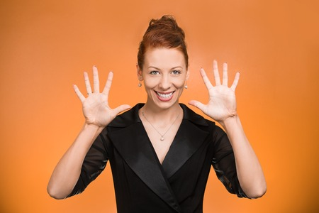 non verbal: Portrait happy, smiling young woman making, showing five times sign gesture with two hands, fingers, isolated orange background. Positive human emotion, facial expression, feelings, symbol, non verbal communication