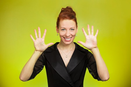 five fingers: Portrait happy smiling young woman making showing five times sign gesture with two hands fingers isolated green background. Positive human emotion, facial expression feeling symbol, non verbal communication Stock Photo