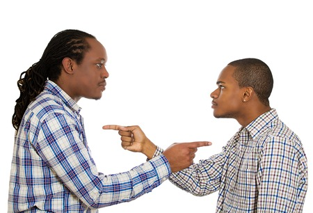 Portrait two angry guys pointing fingers at each other, blaming for problems, mistakes isolated white background. Interpersonal conflict resolution.