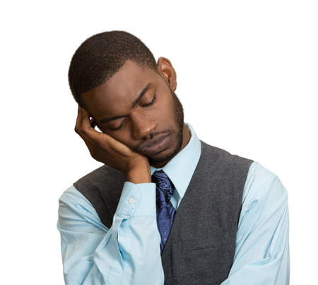 blase: Closeup Portrait Sleepy young Business Man, funny guy placing head on hand, unhappy, Eyes Closed, isolated grey wall background. Negative human emotions, facial expressions, feelings, body language