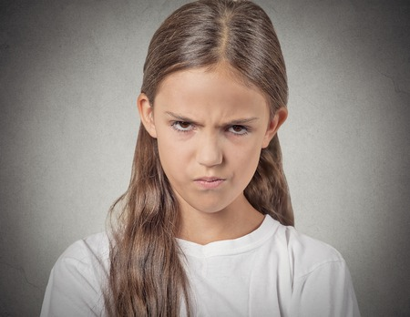 disobey: Closeup portrait Angry young Girl about to have Nervous atomic breakdown displeased isolated grey wall background. Negative human emotions Facial Expression feeling attitude reaction body language Stock Photo