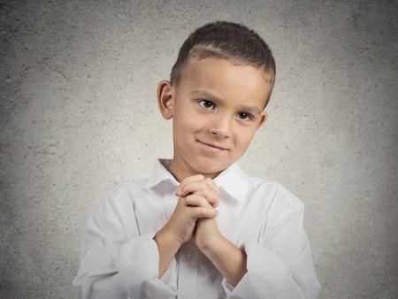 クローズ アップの肖像画の少年は、若い男と身振りで示す固い握手を交わした、かなりしてくださいトップ、孤立した灰色の背景上に砂糖肯定的な 写真素材
