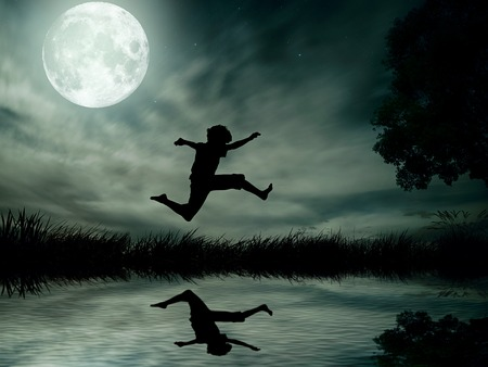 Happy boy, teenager jumping in water, over lake with moonlight, moon background, body reflection in water. Outdoor exciting summer vacation, travel life, leisure. Lifestyle freedom concept. Dreamland  photo