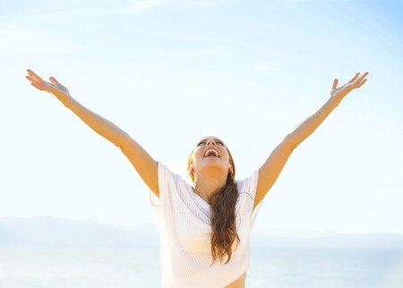 breath: Woman smiling arms raised up to blue sky, celebrating freedom. Positive human emotions, face expression feeling life perception success, peace of mind concept. Free Happy girl on beach enjoying nature