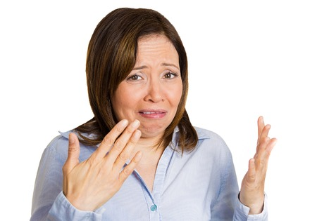 bad business: Closeup portrait middle aged woman disgusted by smell looks displeased, something stinks, bad odor, situation, isolated white background. Human face expressions, body language, perception, senses
