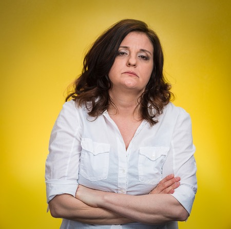 angry teacher: Portrait displeased pissed off angry grumpy woman with bad attitude, arms crossed looking at you, isolated yellow background. Negative human emotion facial expression feeling body language
