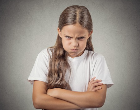 disobey: Angry. Closeup portrait young girl having nervous breakdown isolated grey wall background. Negative human emotions facial expressions feelings, bad attitude, body language, reaction, life perception