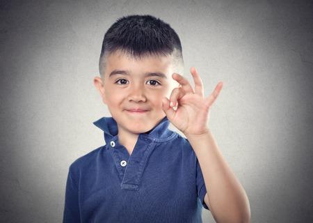 ok happy child. body language, sing, symbol, face expression photo