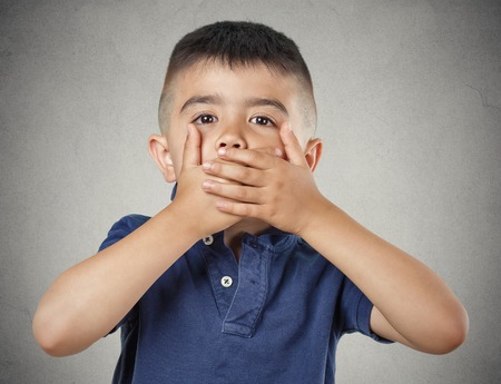 introvert: Closeup portrait young handsome man, boy closing, covering mouth with hands can