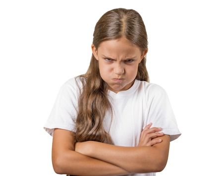 puffing: Angry. Closeup portrait young girl having nervous breakdown isolated white background. Negative human emotions facial expressions feelings, bad attitude, body language, reaction, life perception