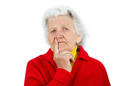 cynical: Closeup portrait senior serious mature woman looking at you camera gesture skeptically, isolated on white background. Negative human emotions, facial expression, feeling, body language, perception Stock Photo