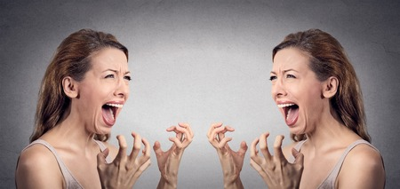 bad feeling: Closeup portrait angry woman hysterical having nervous breakdown screaming pissed off  at herself in mirror isolated grey wall background. Negative human emotion facial expression feeling bad attitude