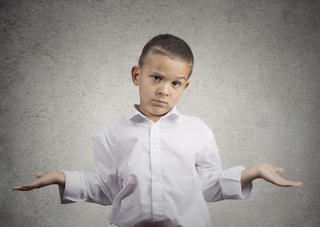 disinterest: Closeup portrait clueless, unhappy child boy with arms out asking what