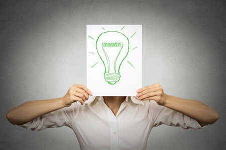 head protection: Businesswoman with green light bulb instead of her head isolated grey wall background. Eco friendly energy recycling solution, electricity savings, earth protection, innovation, ecology, power concept