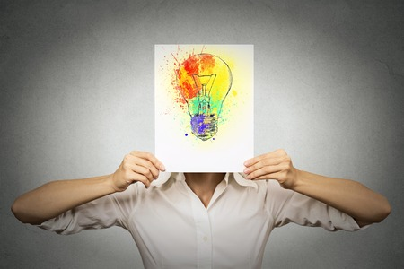 woman having brilliant idea colorful lightbulb covering face isolated grey wall background. Free thinking, new approach, alternative technology. Creativity, imagination, dynamism, intelligence concept