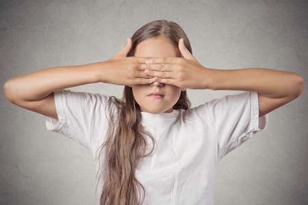 withhold: Portrait young teenager girl closing covering eyes with hands can Stock Photo