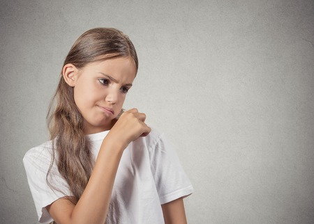 nasty: Closeup portrait teenager girl opening t-shirt to vent, its hot blowing air, unpleasant, awkward situation embarrassment isolated grey wall background. Negative human emotion facial expression feeling