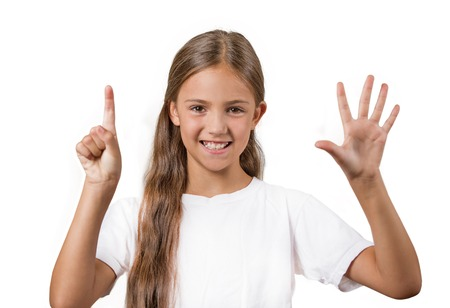 graduation countdown: Closeup portrait excited happy teenager girl showing 6 fingers, giving number six sign, isolated white background. Positive human emotion face expression, attitude, reaction, perception body language Stock Photo