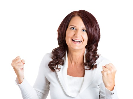 jubilate: happy middle aged woman exults pumping fists ecstatic celebrates success isolated on white background  Stock Photo
