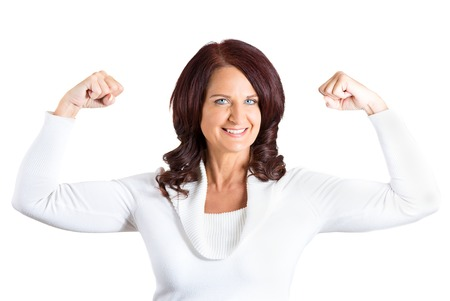 d: Closeup portrait middle aged woman flexing muscles showing, displaying her strength, isolated white background. Positive human emotions, facial expressions, feelings, attitude, life perception