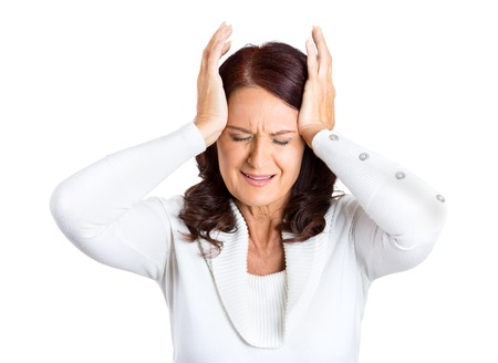 bothered: Closeup portrait unhappy stressed middle aged business woman hands on heads bothered by mistake, having bad headache isolated on white background. Negative human emotion facial expression feelings