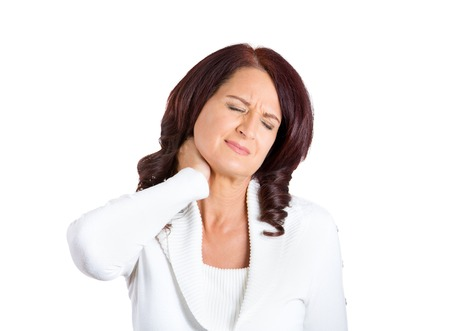 muscle relaxant: Closeup portrait stressed unhappy business woman with bad neck pain, after long hours of work or studying, isolated on white background. Negative human emotion facial expression feelings