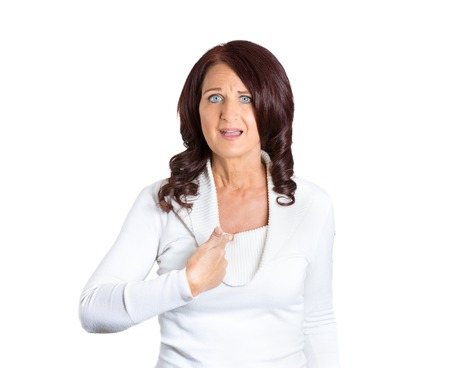 misconception: Closeup portrait mad angry unhappy annoyed middle aged woman asking question whats problem you talking to mean me? Isolated white background. Negative human emotion facial expression reaction feeling