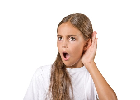 intrusive: Closeup portrait nosy teenager girl hand to ear gesture carefully intently secretly listening in on juicy gossip conversation news privacy violation isolated white background. Human face expression