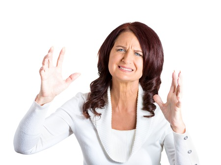closeup portrait angry woman upset with situation isolated on white background. Negative human face expressions, emotions, feelings, attitude, body language, life perception photo