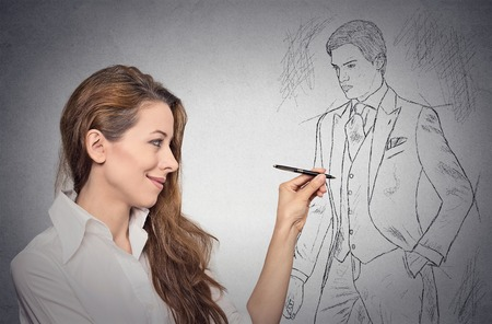 woman stylist drawing sketch of male model dressed in suit