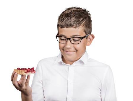 sweet tart: Carbs cravings. Portrait teenager boy craving cake confused funny looking man trying to withstand resist temptation to eat sweet tart isolated white background. Facial expression emotion reaction