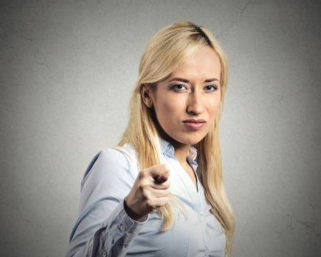 Closeup portrait upset woman gesturing with thumbs, finger that you get zero nothing, isolated grey wall background. Negative emotion facial expression feelings, body language sign. Failed negotiation photo