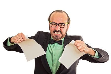 wrest: Unhappy angry businessman tearing a document to pieces