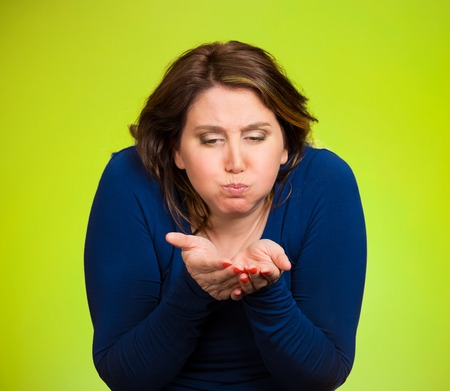 Closeup portrait middle aged sick woman about to vomit, chuck, throw up, puke, retch barf, hurl isolated green background. Negative human emotions, feelings, facial expressions. Excessive drinking photo