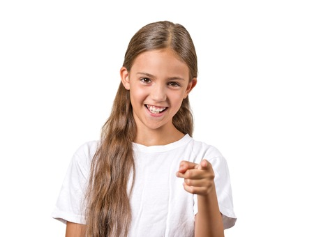 Portrait happy teenager girl pointing finger laughing smiling surprised by something isolated on white background. Positive human emotion facial expression feeling reaction body language