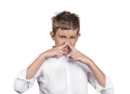 stinks: Closeup portrait young man with disgust on face, pinches his nose, something stinks, bad smell, situation isolated white background. Negative emotions, facial expressions, perception body language