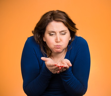 Closeup portrait middle aged sick woman about to vomit, chuck, throw up, puke, retch barf, hurl isolated orange background. Negative human emotions, feelings, facial expressions. Excessive drinking photo