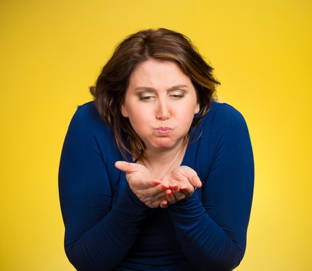 Closeup portrait middle aged sick woman about to vomit, chuck, throw up, puke, retch barf, hurl isolated yellow background. Negative human emotions, feelings, facial expressions. Excessive drinking photo