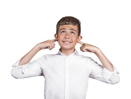 deafening: Closeup portrait young, angry, unhappy, stressed man covering his ears, looking up, to say, stop making loud noise its giving headache, isolated white background. Negative emotions, face expressions Stock Photo