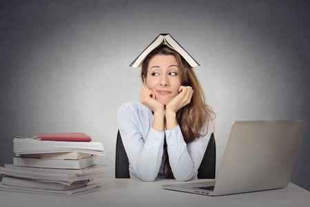 Closeup portrait annoyed woman  fed up of studying, isolated grey blackboard  background.  Stockfoto